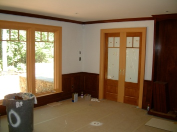 faux bois mahogany finish over construction grade poplar - private residence - wayland, ma (this picture shows beginning steps of painting during construction phase)