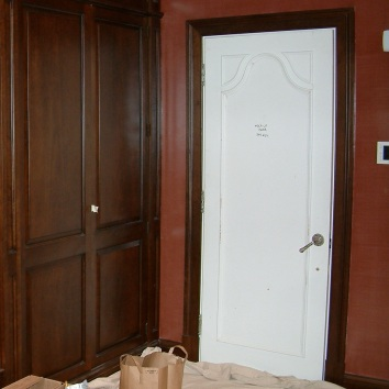 replacement door before being painted in a faux bois finish to match existing genuine walnut woodwork private residence - brookline, ma