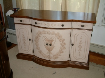 painted, glazed and antiqued buffet with classical floral motif