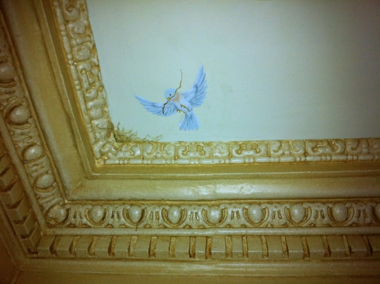 trompe l'oeil bluebird nesting above moulding - boston, ma