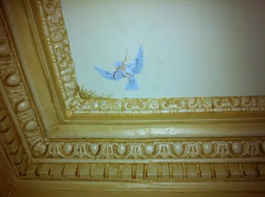 trompe l'oeil bluebird nesting above moulding - boston, ma